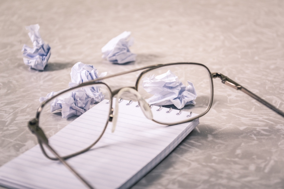 glasses-in-front-of-crumpled-paper